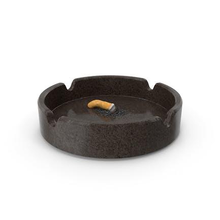 Put out cigarette in granite ashtray
