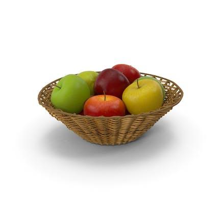 Cesta de mimbre con manzanas