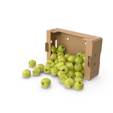 Caja de cartón con manzana dorada deliciosa derramada