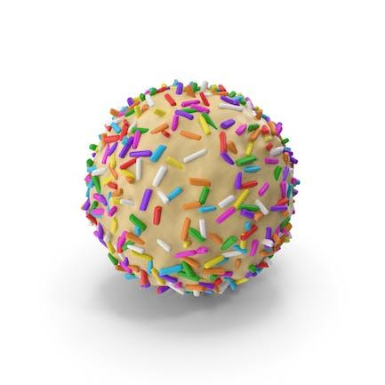 Weißer Schokoladenball mit farbigen Pops