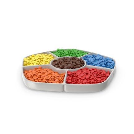 Cuenco con compartimento con caramelos de colores