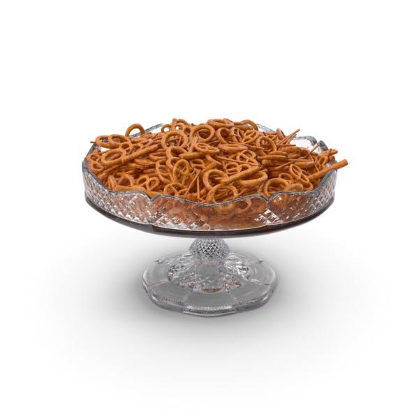 Необычная хрустальная чаша со смешанными закусками кренделя