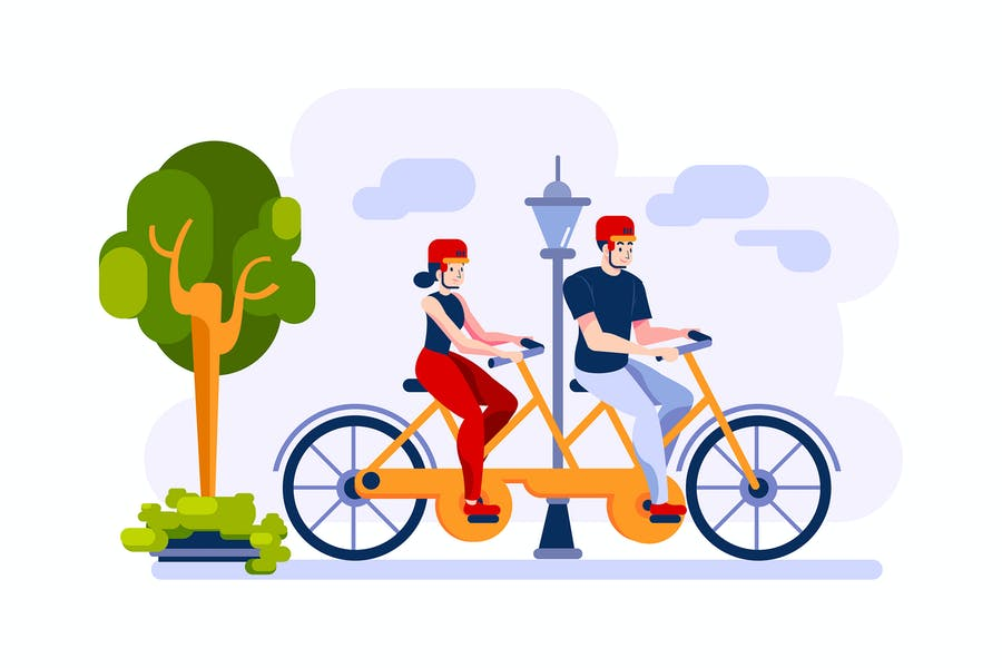 Couple are cycling on double bike in the park