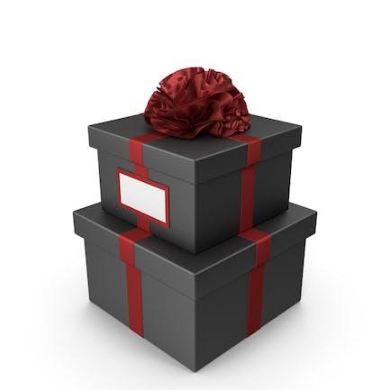 Schwarze Geschenkbox mit rotem Band und Karte