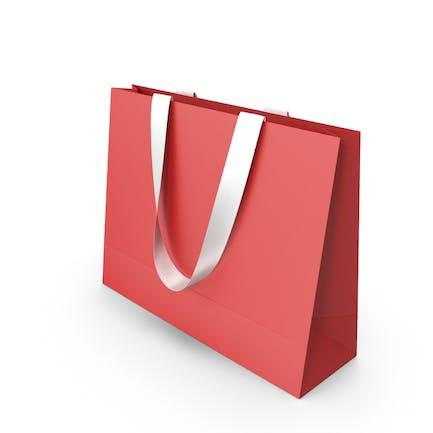Красная бумажная сумка с белыми ручками
