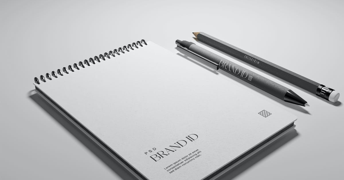 Download Notepad with Pen and Pencil Mockup by megostudio