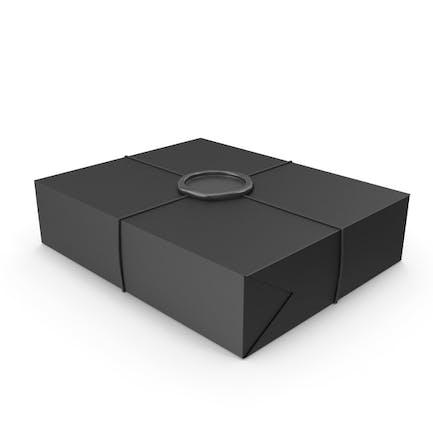Schwarze Geschenkverpackung mit Wachssiegel