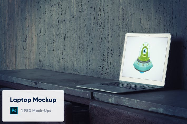 Laptop on Old Concrete Background PSD Mockup