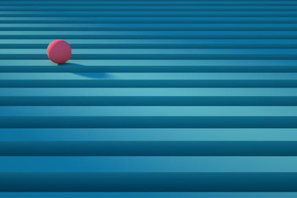 Geometric pink sphere rolling over a blue stripe