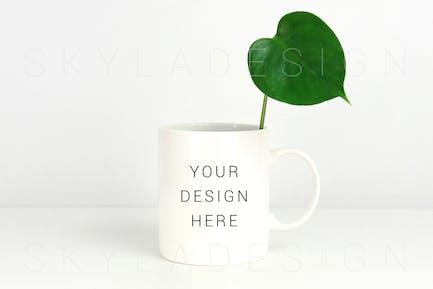 White coffee mug mockup green leaf