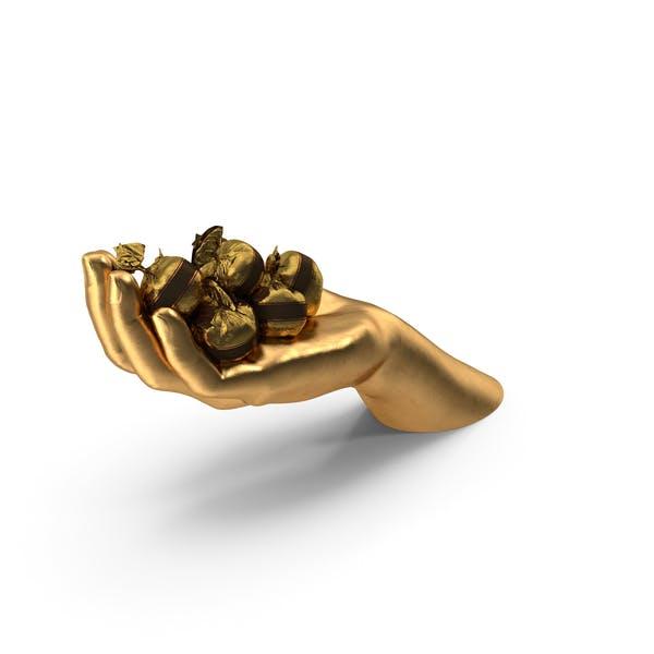 Goldene Hand Handvoll mit ausgefallenen Schokoladen-Bonbons