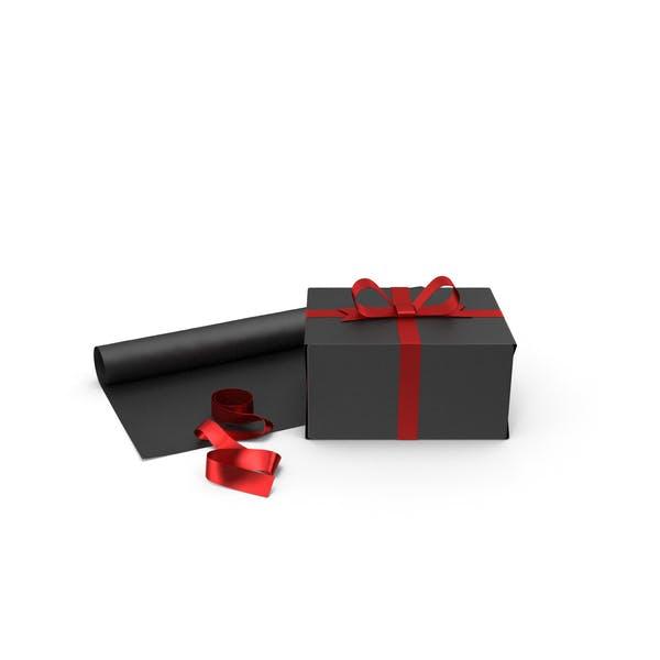 Черная подарочная коробка с рулоном бумаги и лентой из красной фольги