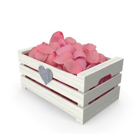 Caja de madera con pétalos rosa