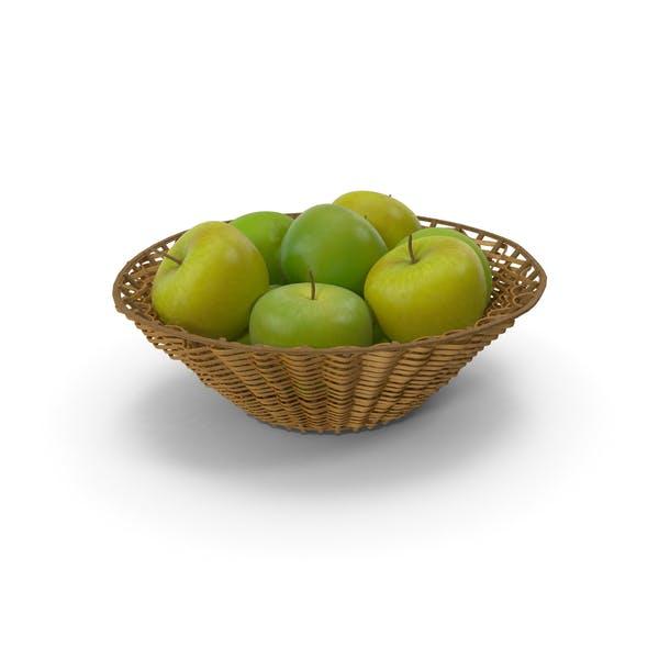 Cesta de mimbre con manzanas verdes