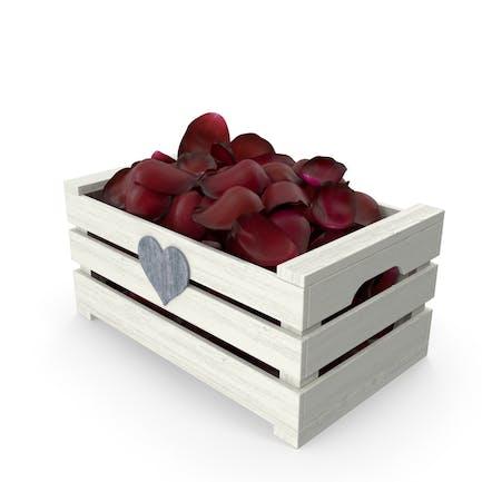 Caja de madera con pétalos
