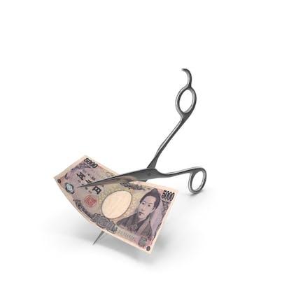 Scissors Cutting a 5000 Japanese Yen Banknote Bill