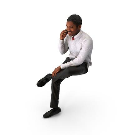 Hombre de negocios de primavera sentado en el teléfono