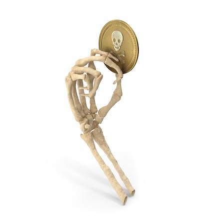 Mano esqueleto sosteniendo una moneda de cráneo