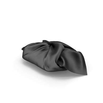 Geschenkpapier aus schwarzem Stoff.