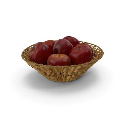 Cesta de mimbre con manzanas rojas