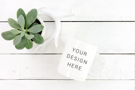 White coffee cup mockup plant
