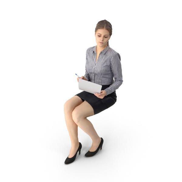 Бизнес-женщина сидит