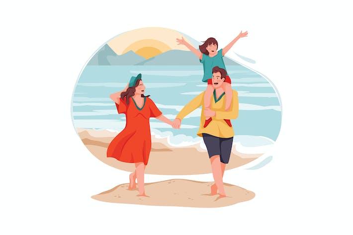 Happy family walking on the ocean beach