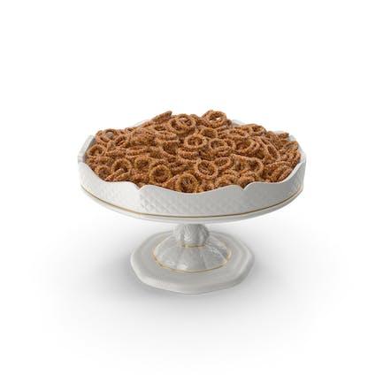 Fancy Porcelain Bowl With Mini Pretzel Rings With Sesame