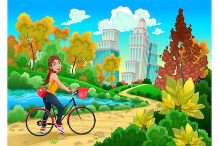 Señora en una bicicleta en un parque urbano