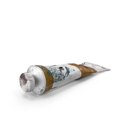 Tubo de pintura acrílica ocre sucia