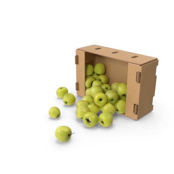 Картонная коробка с золотым вкусным яблоком, пролитым