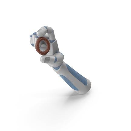 Robothand hält einen mit Schokolade überzogenen Brezelring