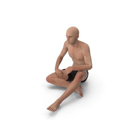 Спортивный человек сидит на полу
