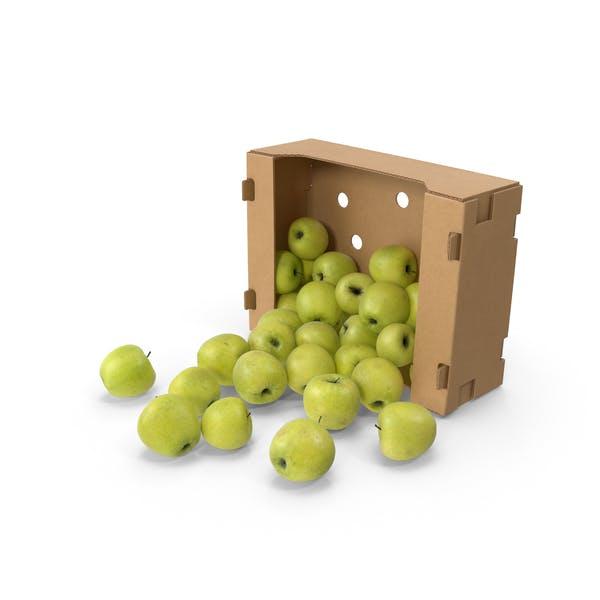 Коробка с золотым вкусным яблоком, пролитым