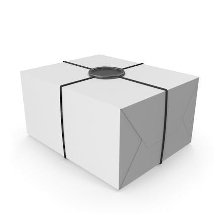 Weiße Geschenkverpackung mit Wachssiegel