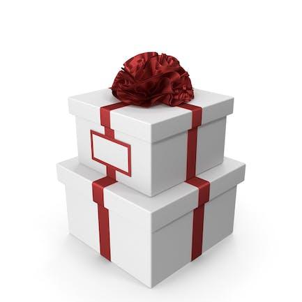 Белая подарочная коробка с красной лентой и открыткой