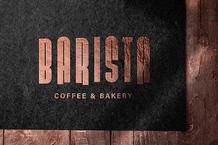 Embossed bronze logo mockup on dark paper