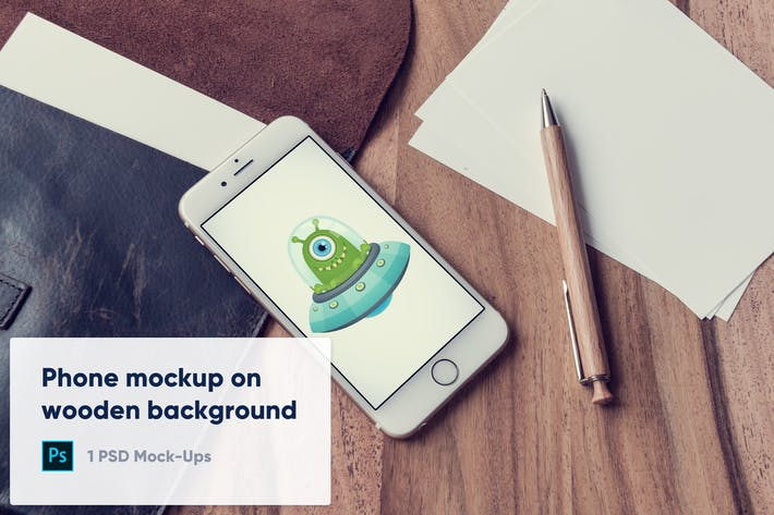 Thumbnail for Phone and Blank Paper on Wooden Background Mockup