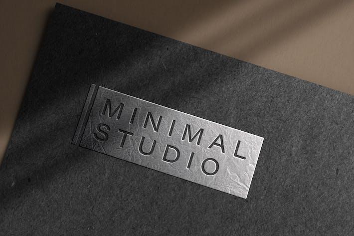 Embossed silver logo mockup on dark paper