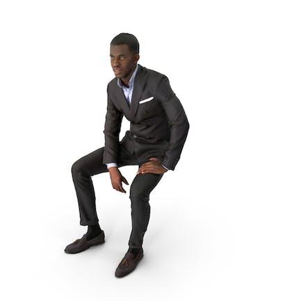 Hombre de negocios de primavera sentado