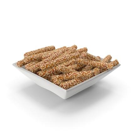 Square Bowl with Pretzel Sticks with Sesame