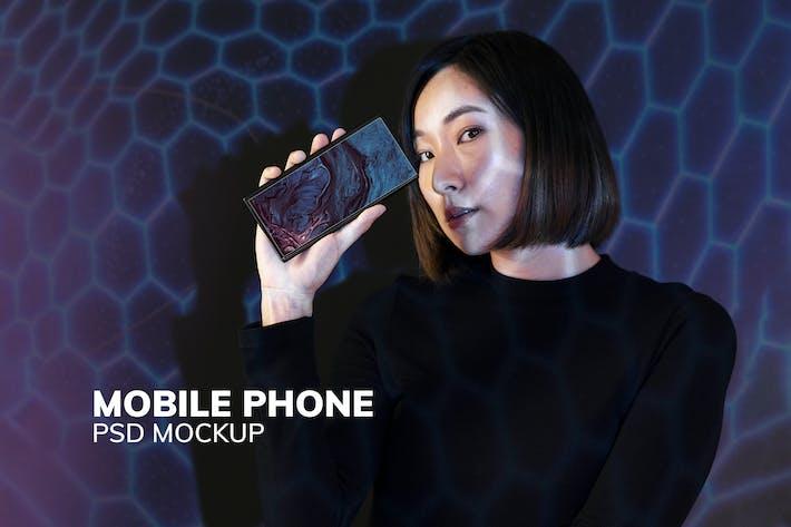 Woman showing smartphone screen mockup psd