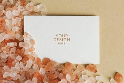 Blank white business card on orange gravel