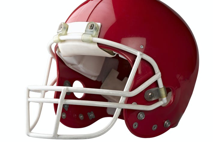 Cover Image For Red American football helmet isolated
