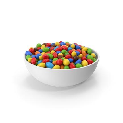 Cacahuetes de colores en cuenco