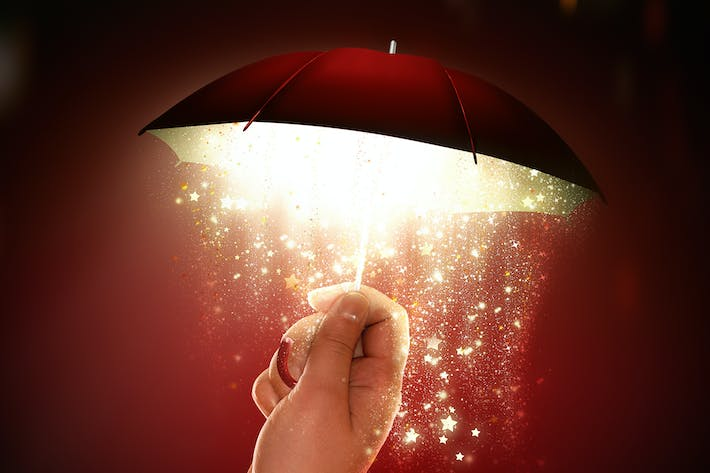 Thumbnail for hand holds a bright umbrella with a magical glow