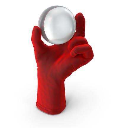 Guante que sostiene la bola de cristal