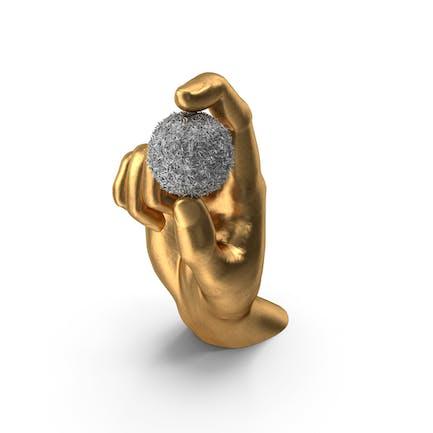 Goldene Hand hält einen Schokoladenball mit Pops