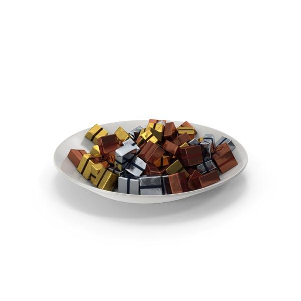 Teller mit eingewickelten quadratischen Schokol