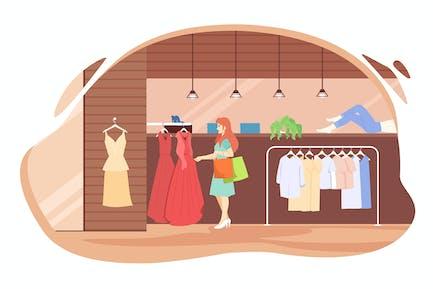 Mädchen wählt ein Kleid im Laden. Einkaufen.